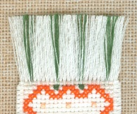 Colorful bookmark accents added to a fringed bookmark