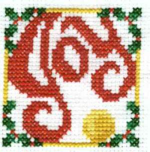Joy Christmas Cross Stitch with Holly Providing the Corners